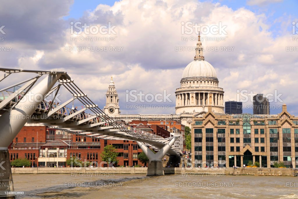 Millenium Bridge, London Millenium Bridge with St Pauls Cathedral in the back, London, United Kingdom. Architectural Dome Stock Photo