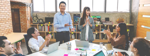 Millennial boss team leader introducing new asian woman employee to picture id1178087243?b=1&k=6&m=1178087243&s=612x612&w=0&h=bozvnsm5xwrrjo6lxjr70gepwa8nedc8khcjmicpxkc=