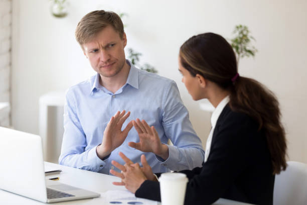 Millennial businessman rejecting giving interview to journalist Funny businessman rejecting to give interview to journalist. Stop sign. Man from recruitment management stopping interviewing lady, fraud, unhappy customer complaining, demanding compensation negative emotion stock pictures, royalty-free photos & images
