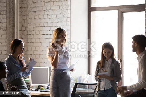 istock Millennial businesswoman hold meeting with colleagues in office 1129819919