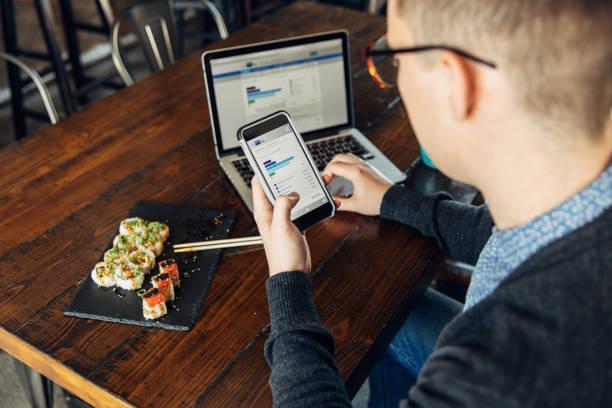 Millennial Checking Finances on Smart Phone stock photo
