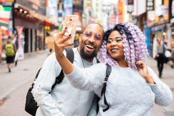 Millennial couple posing for a selfie stock photo