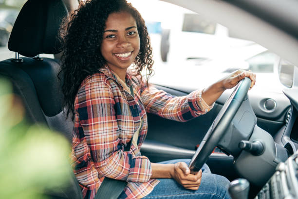 Millennial Driver Millennial Driver afro caribbean ethnicity stock pictures, royalty-free photos & images