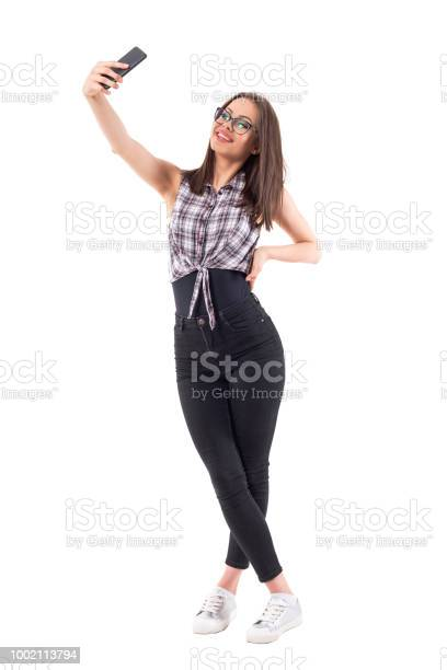 Millennial female stylish hipster girl smiling and posing for taking picture id1002113794?b=1&k=6&m=1002113794&s=612x612&h=nuyulow1bh12wefwzysn2 a1nascvankbtbaetb36be=
