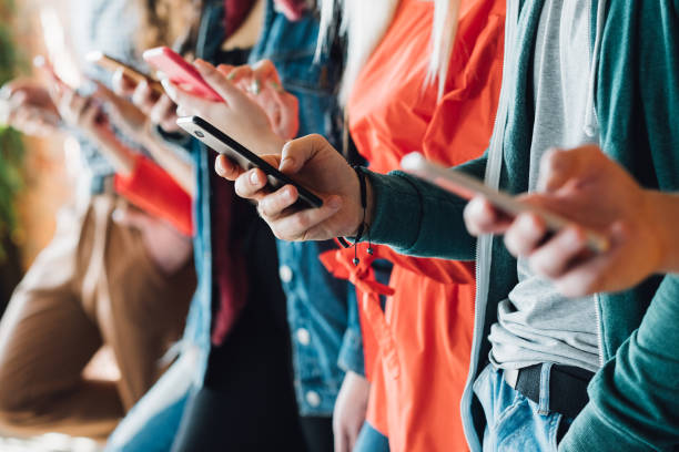 millennial generation modern devices technology Millennial generation. Colorful cropped closeup of young people holding smartphones. Modern devices. Technological progress. ancestry stock pictures, royalty-free photos & images