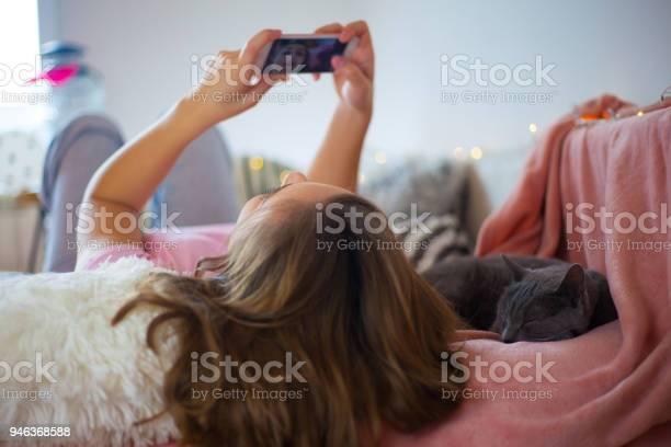 Millennial girl celebrating her cats birthday picture id946368588?b=1&k=6&m=946368588&s=612x612&h=kqhckxbhp0i 9xu l8ffxljzjzcrmkw0r081lgbtlie=