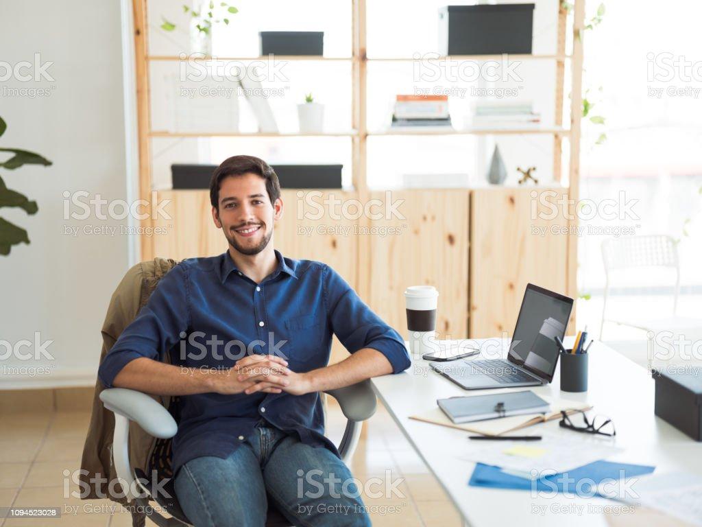 Millennial hispanic man in his office stock photo