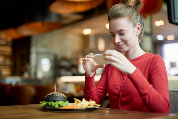 millennial in cafe - foodie stock photos and pictures