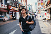 South Korean youth lifestyle in the capital city. Mixed race young millennial man half Korean, half Russian living and studying in Seoul.