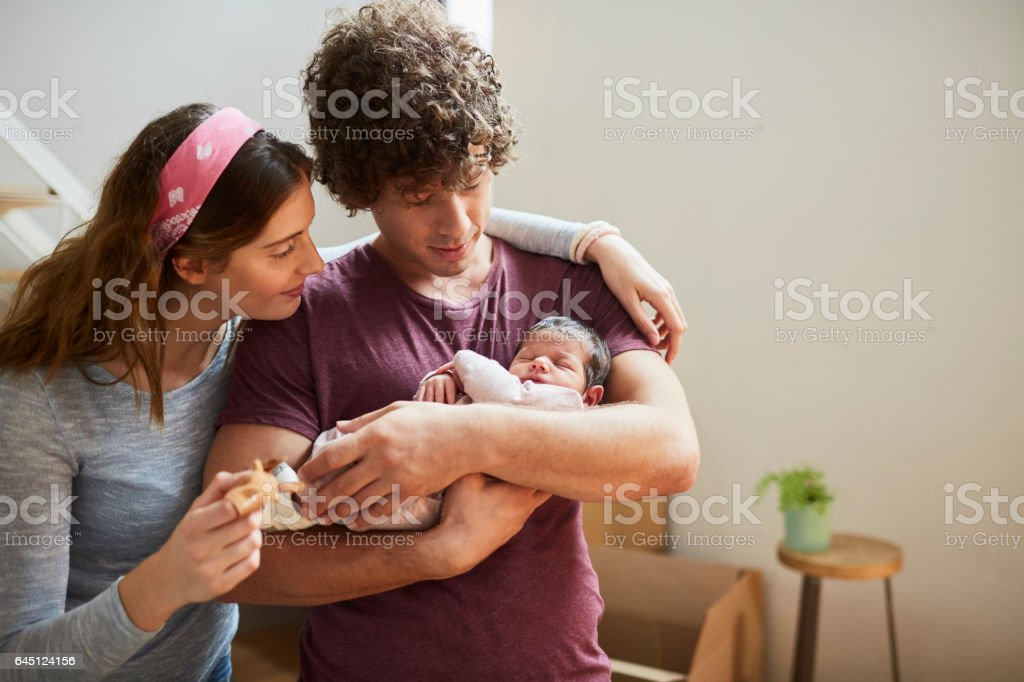 Millennial Parents moving to a new flat. stock photo