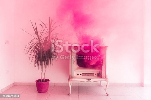 Pink Smoke coming out of an old TV