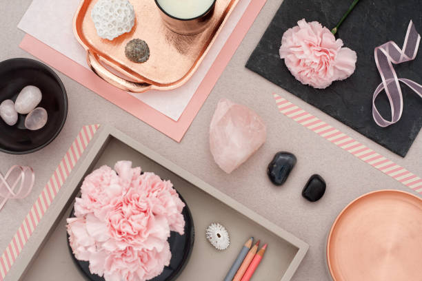 Millennial Rose Quartz Still life Rose quartz background with several decorative objects, gemstones, seashells and candle. crystal healing stock pictures, royalty-free photos & images