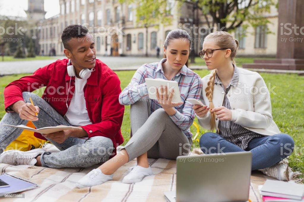 Millennial students discussing modern fashion trends royalty-free stock photo