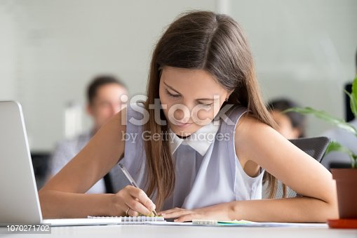 1083827722 istock photo Millennial teen girl making notes preparing for test or exam 1070271702