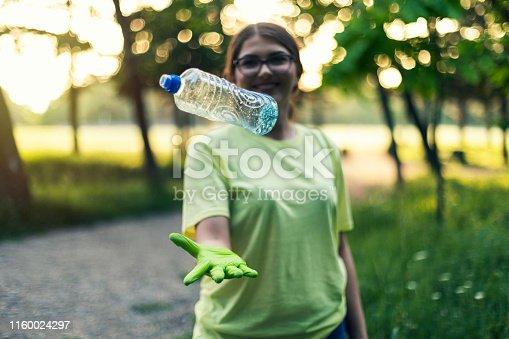 istock Millennial Volunteer Girl With a Plastic Bottle 1160024297