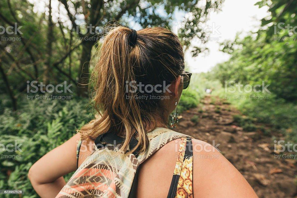Millennial Woman Hikes Scenic Nature Trail Travel Destination Hawaii stock photo