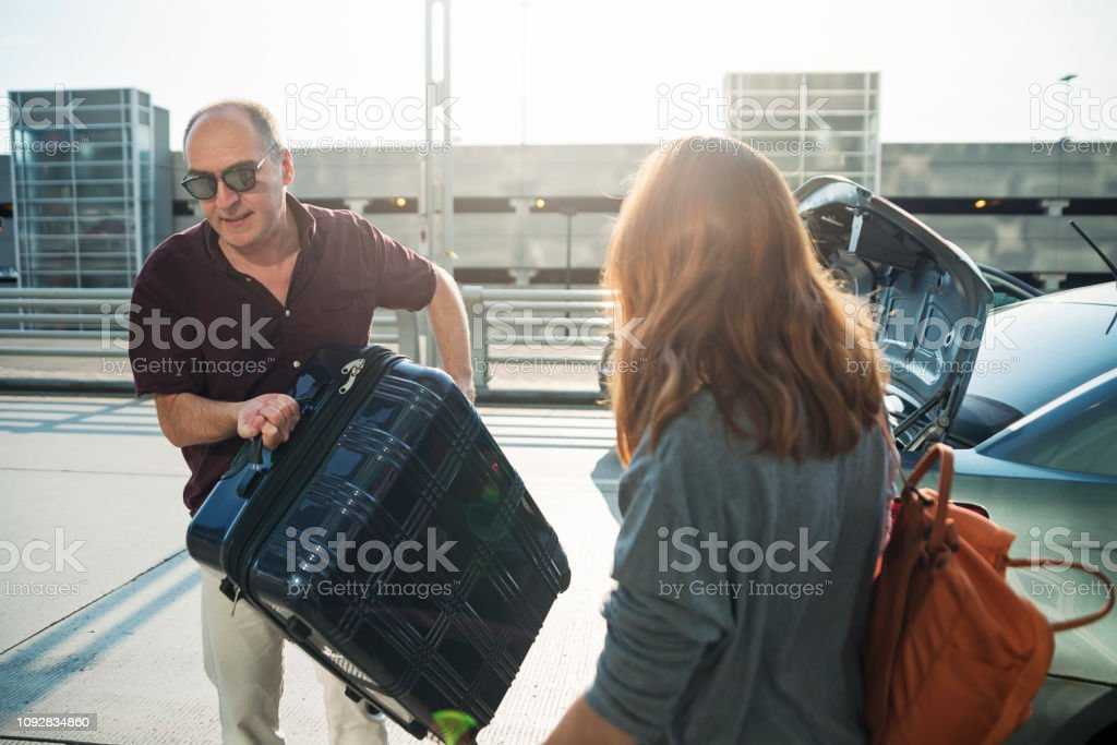 Millennial woman traveling in airport. stock photo