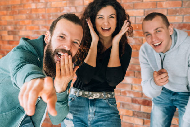 millennials amused cheerful laughing emotional - disdainful stock pictures, royalty-free photos & images