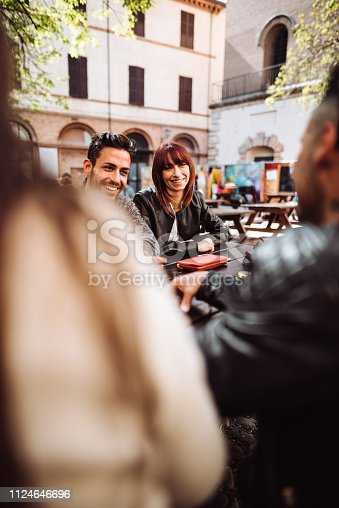 911294484istockphoto millennials at the cafe using the phone 1124646696