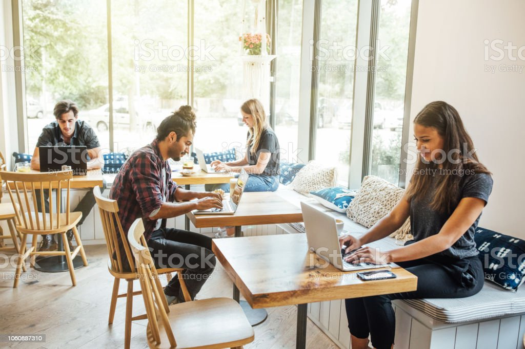 Millennials at wifi cafe stock photo