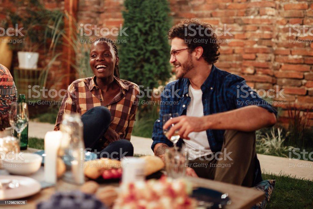 Millennials enjoying dinner in outdoor restaurant