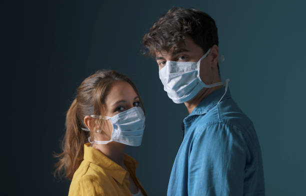 Millennials wearing a protective face mask stock photo