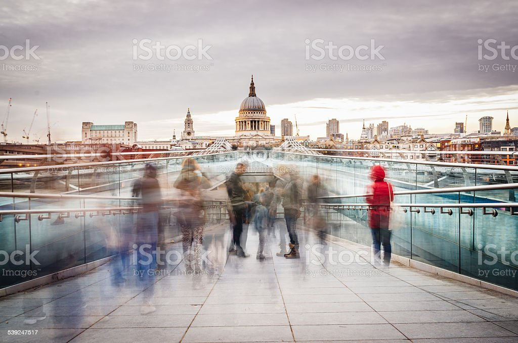 Millennium Bridge And St. Paul Cathedral In London stock photo