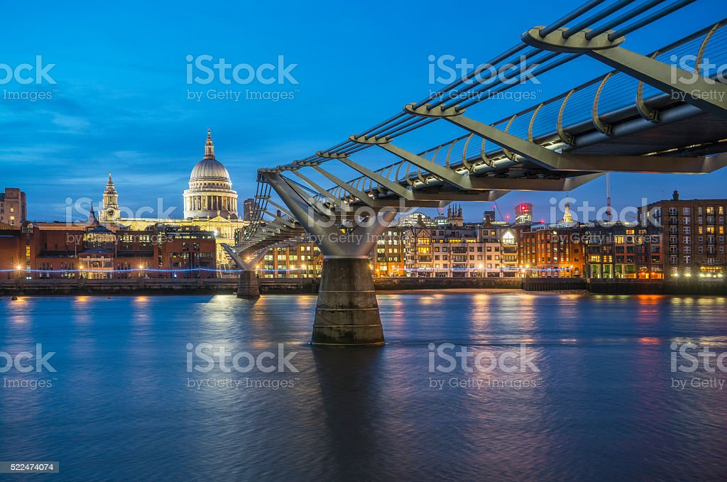 Millennium Bridge and St. Paul's cathedral at dusk stock photo
