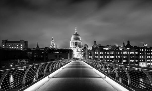Millennium Bridge And St Paul's Cathedral At Night stock photo