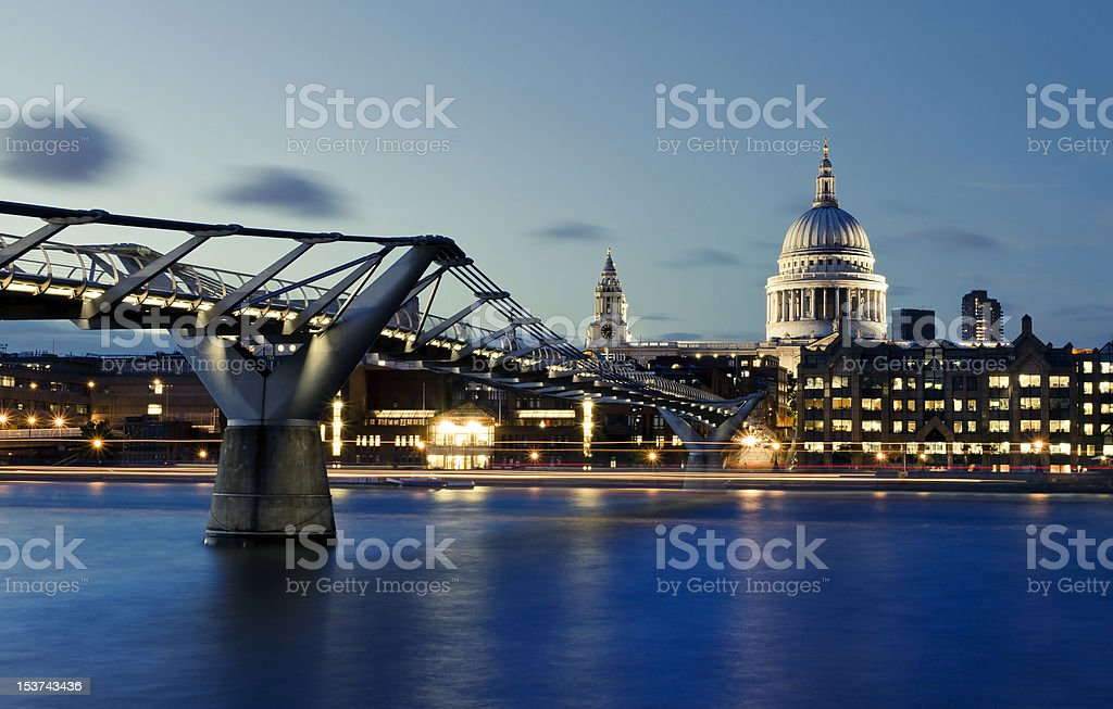 Millennium bridge and St. Paul's cathedral stock photo