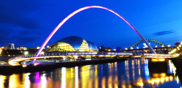 millennium bridge at newcastle quayside at night - gateshead stock photos and pictures