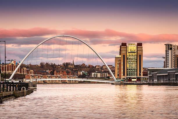 millennium bridge at sunset - gateshead stock photos and pictures