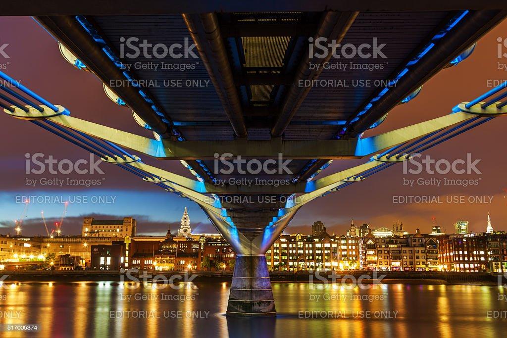 Millennium Bridge in London, UK, at night stock photo