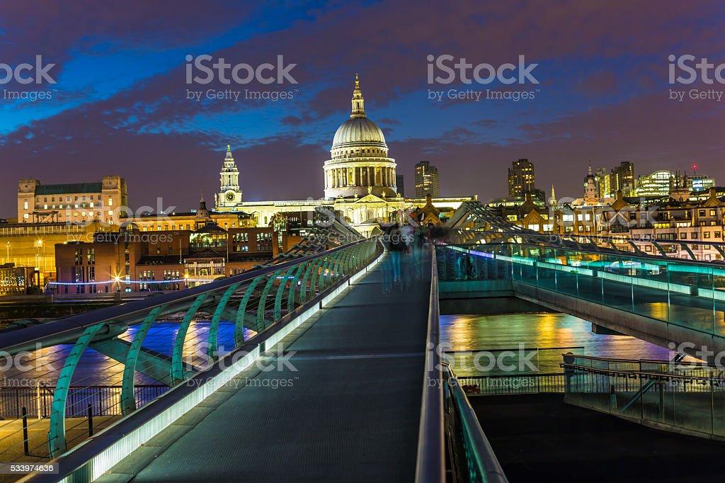 Millennium Bridge, Saint Paul's Cathedral London at night stock photo