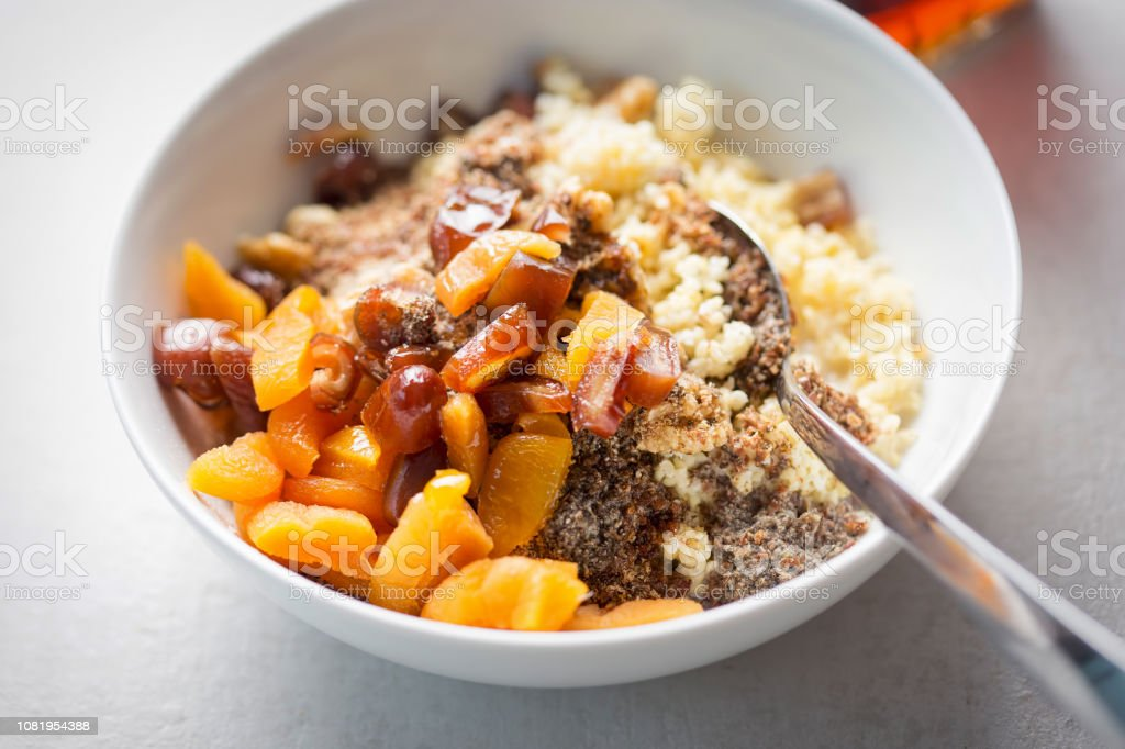 Millet grain with dates, apricots, chia seeds and milk thistle stock photo