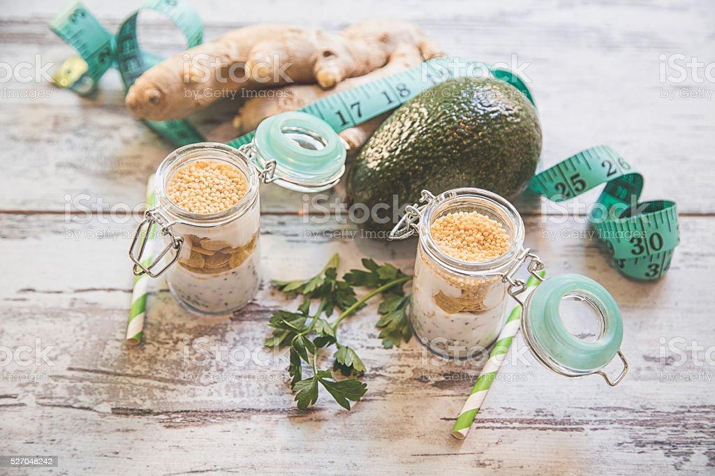 Millet porridge with milk and fruits stock photo