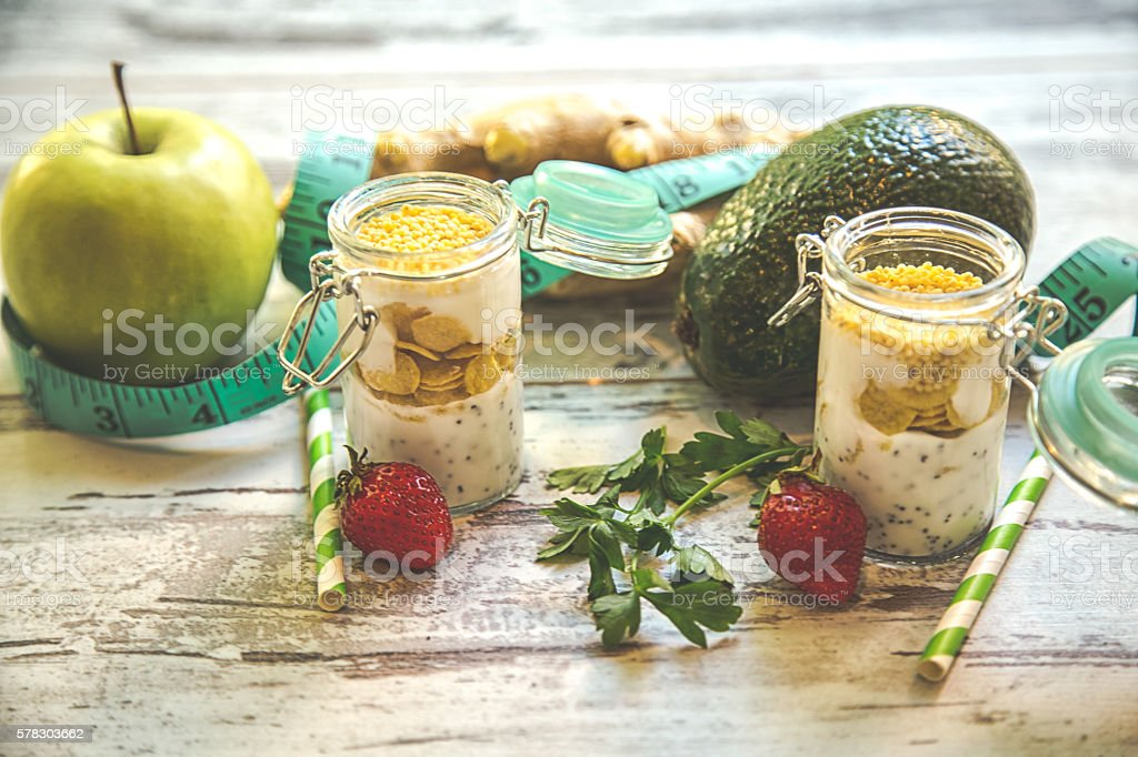 Millet porridge with milk and fruits stock photo