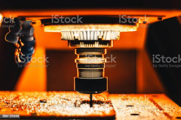 Milling Cnc Maching In Strong Orange Light Stock Photo - Download Image Now