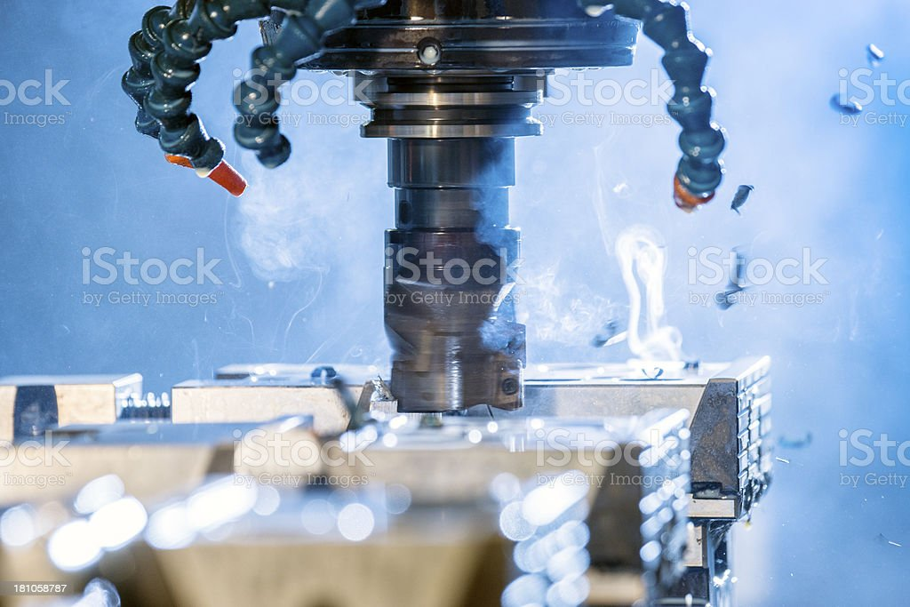 CNC, milling machine cutting steel in a factory stock photo