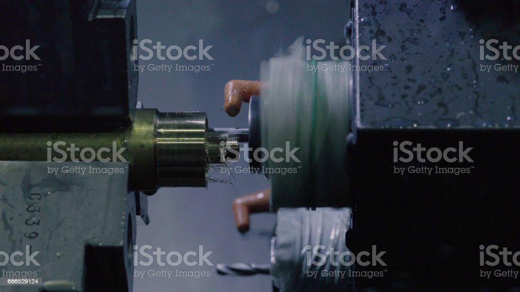 CNC milling machine makes some steel part foto stock royalty-free