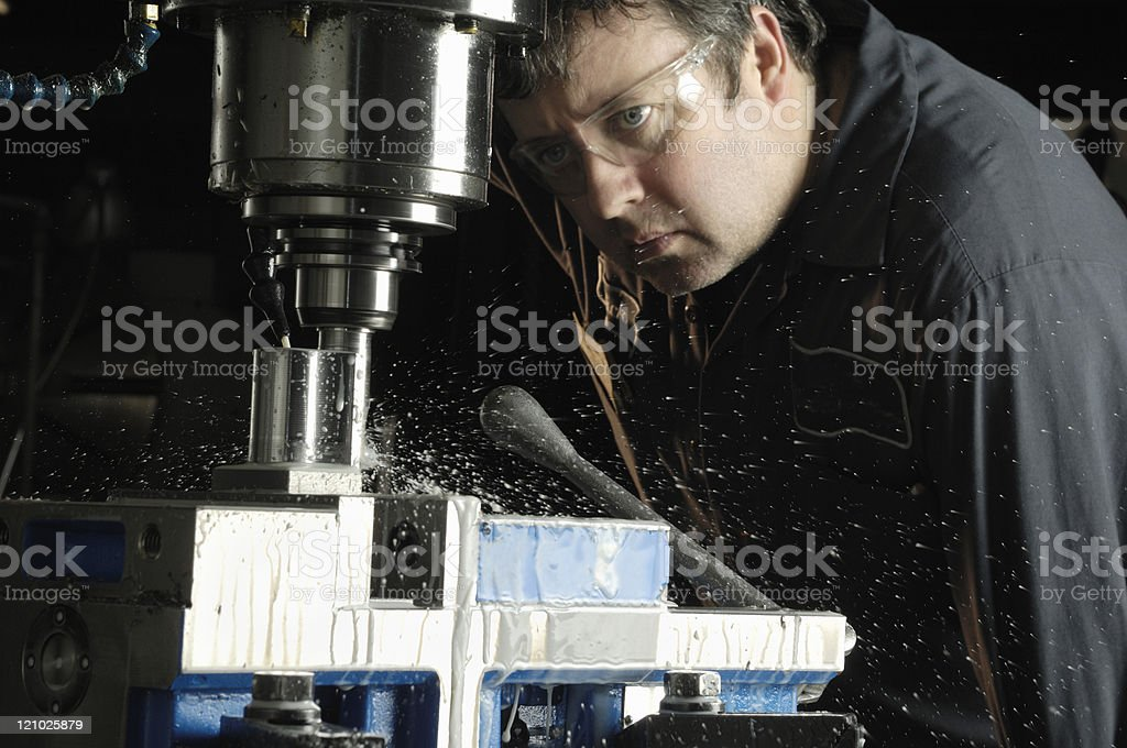 Milling machine operator stock photo