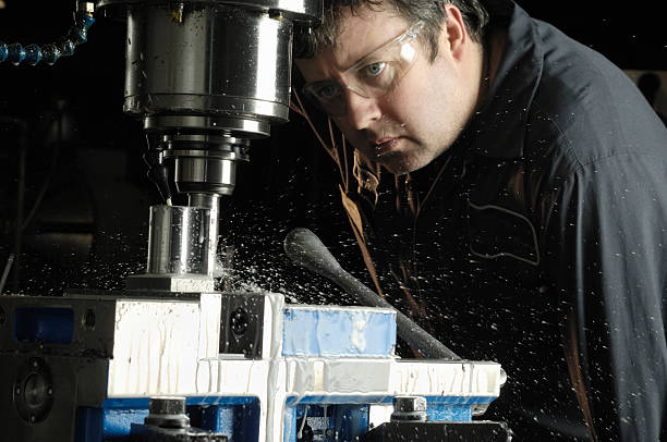 Milling machine operator  metal worker stock pictures, royalty-free photos & images