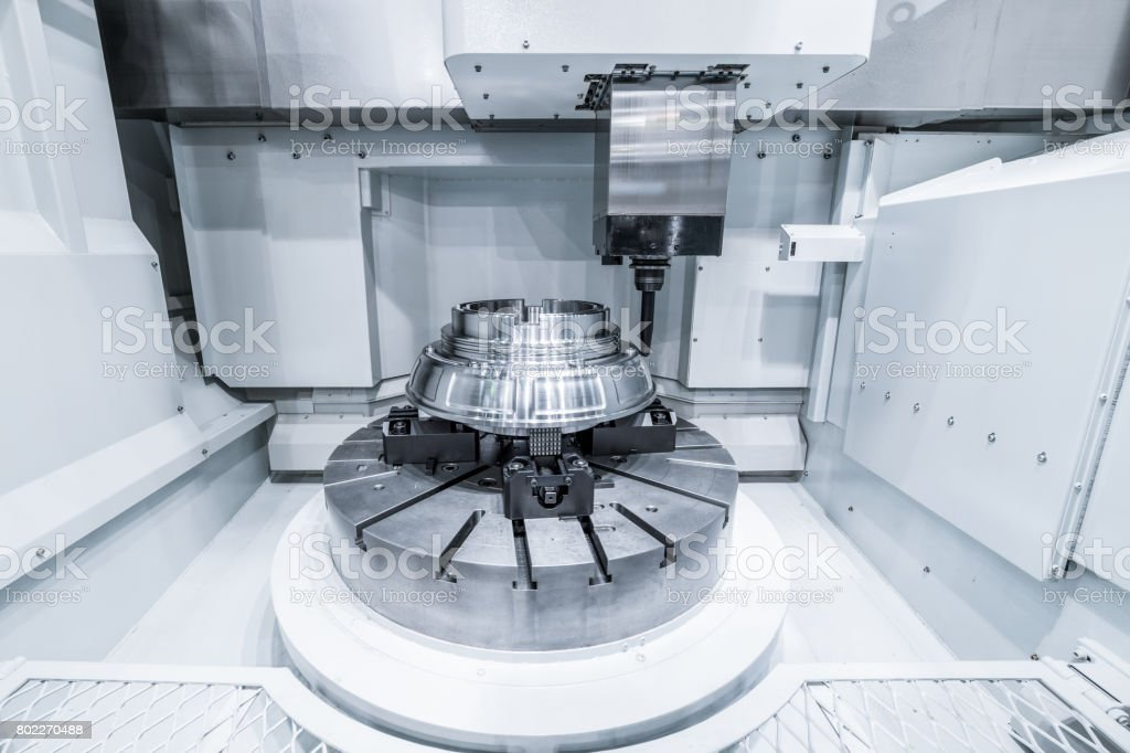 CNC milling machine produces a large part machining stock photo