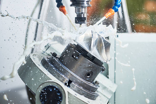 Milling metalworking process. Industrial CNC metal machining by vertical mill Milling metalworking process. Industrial CNC machining of metal detail by cutting end-tooth vertical mill at factory metal worker stock pictures, royalty-free photos & images
