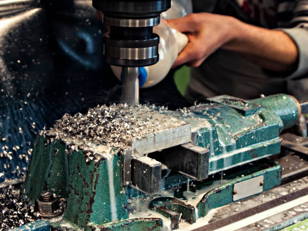 Milling metalworking process. Milling metalworking process. Precision industrial CNC machining of metal detail by cutting mill at factory miller park stock pictures, royalty-free photos & images
