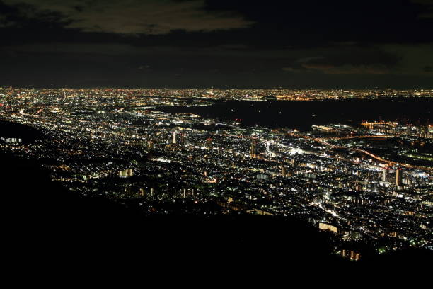 10 million dollars night view of Kobe, Japan 10 million dollars night view of Kobe, Japan maya mountains stock pictures, royalty-free photos & images