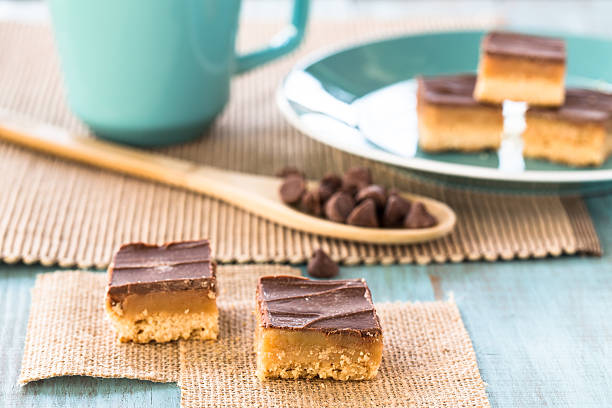 Millionaire Bars Chocolate Caramel Cookies With Coffee Cup stock photo