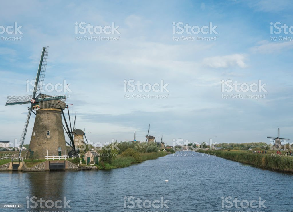 Mills in a row along the river Alblas in Kinderdijk, The Netherlands stock photo