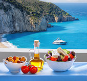 Milos beach with greek salad on Lefkas island in Greece