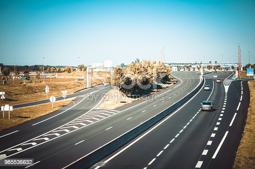 istock Miltilane highway with a toll payment point 985536632